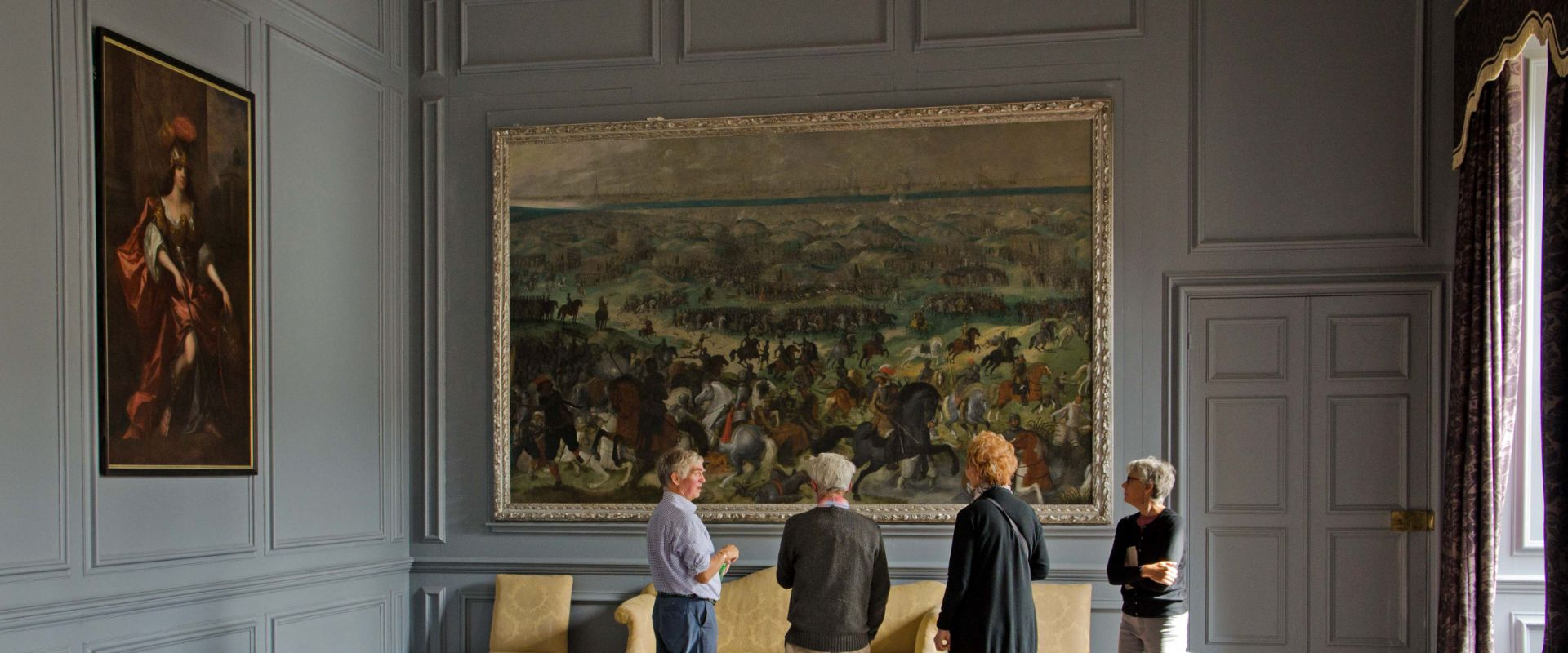 Admiring a painting inside Great Fulford