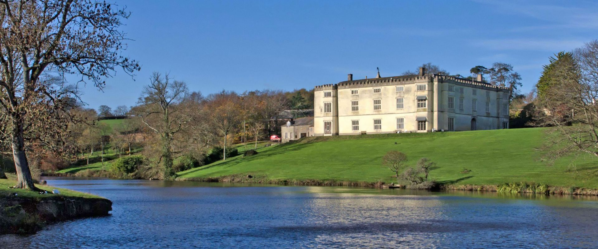 The lake and house at Great Fulford