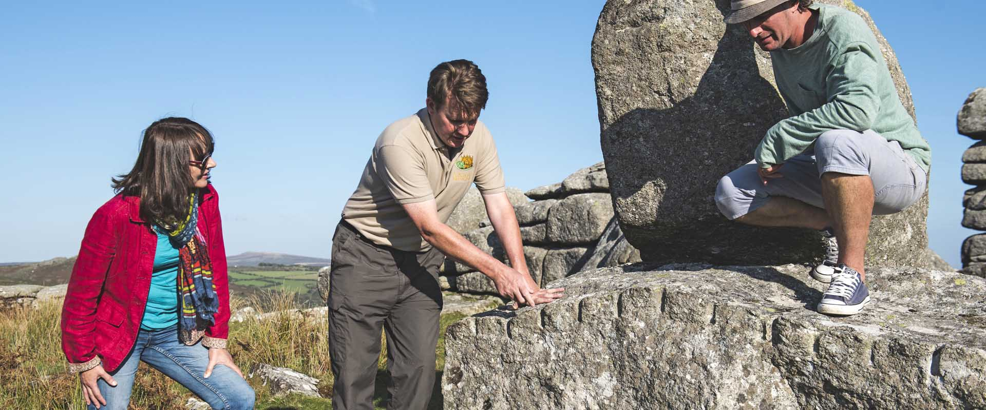 Guests on tour at Combestone Tor on Dartmoor