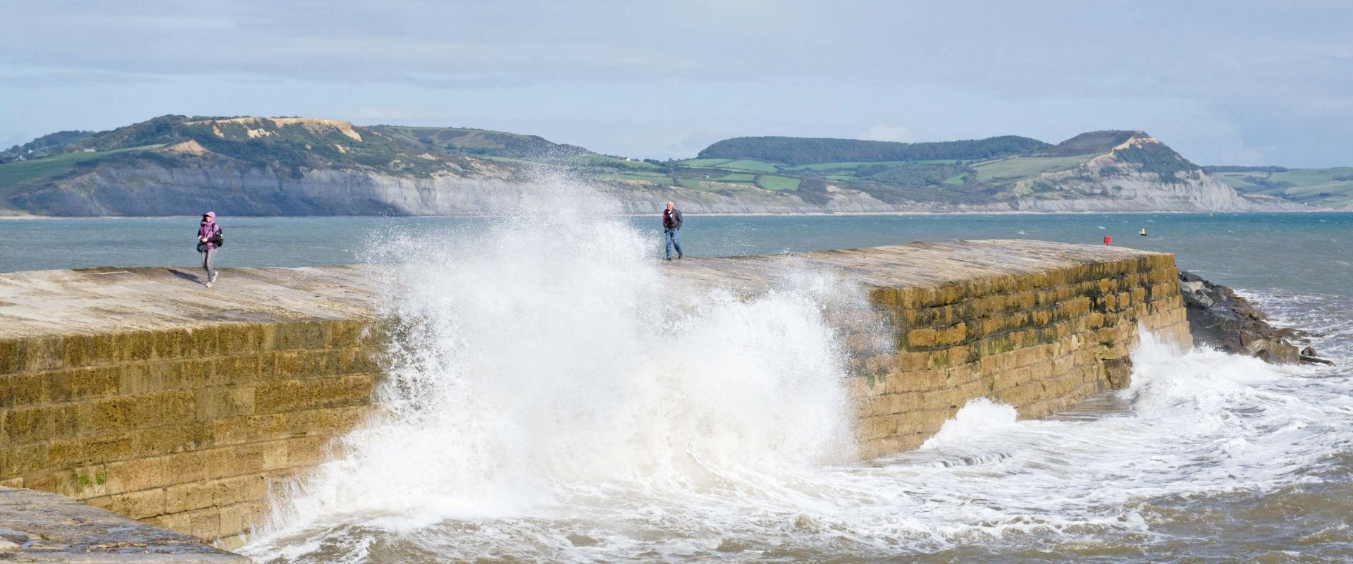 The Cobb at Lyme Regis being hit by winter storms