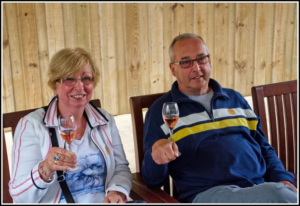 Guests enjoying a wine tasting at Sharpham Vineyard